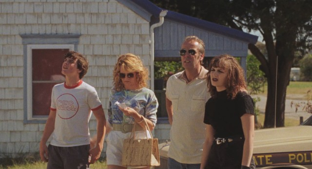 All ready for an awkward family photo, the Miracles (Marcello Conte, Lea Thompson, John Hannah, and Helena Seabrook) set their sights on their rented Ocean City summer home.