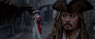 Captain Jack Sparrow (Johnny Depp) is ordered to halt by an armed British redcoat not long for this world.