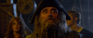 Angelica's father is Edward Teach (Ian McShane), a pirate known as Blackbeard, though the beard looks more white to me.