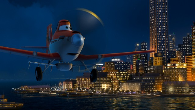 "Crop duster turned racer Dusty Crophopper takes in the view of New York City's coast on a night flight in Disney's ""Planes."""