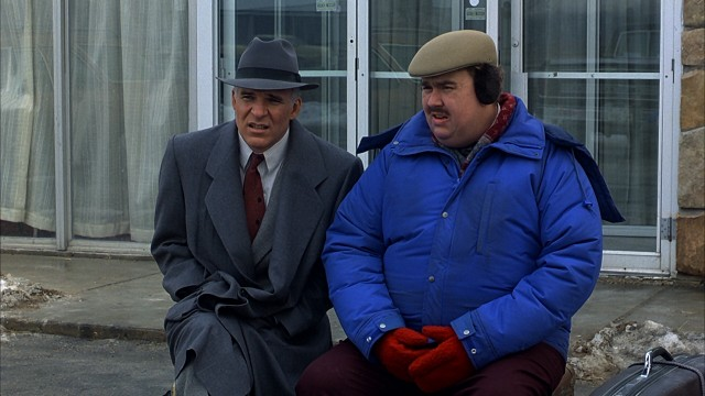 "In ""Planes, Trains & Automobiles"", Steve Martin and John Candy play strangers bound together by circumstance and transportation challenges in an attempt to reach Chicago by Thanksgiving."