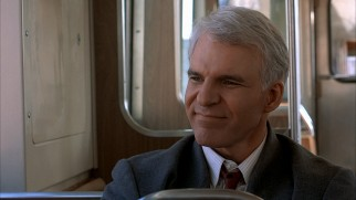 On the elevated subway home, Neal Page (Steve Martin) reflects on his three days of misadventures.