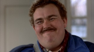 Del Griffith (John Candy) is as happy as can be in the film's memorable closing freeze frame.