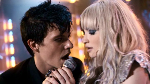 "New guitarist Enzo (Xavier Samuel) gets unnecessarily close to rock singer Hayley St. Claire (Emily Browning) as she sings about her late brother in ""Plush."""