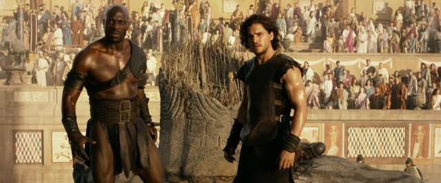 "Atticus (Adewale Akinnuoye-Agbaje) and Milo (Kit Harington), two gladiators assigned to fight each other to the death, join forces against a common enemy in ""Pompeii."""