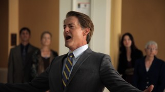 Kyle MacLachlan returns as Portland's easygoing mayor, seen here belting out the city's national anthem.