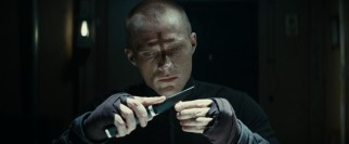 Our unnamed protagonist priest (Paul Bettany) prepares for vampire slaying by etching crosses into bullets.