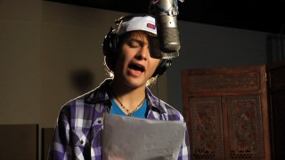 "Nolan Sotillo consults the lyrics to the Spanish version of his end credits song, ""Juntos Lo Haremos Bien"", translating roughly to ""We Go Together Well."""