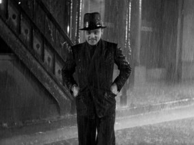 "Tom Powers (James Cagney) goes for a rainy walk in the 1931 gangster classic ""The Public Enemy."""