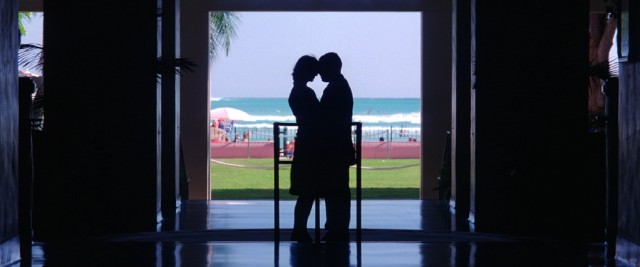 Meeting in Hawaii, Lena and Barry create one of the film's many artful images in this silhouettes in front of scenery shot that was used in the film's theatrical one-sheet.