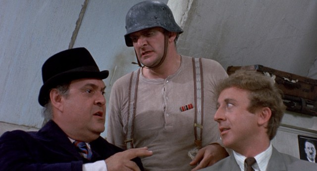 "Producers Bialystock and Bloom (Zero Mostel and Gene Wilder) secure the rights to ""Springtime for Hitler"" by patronizing its passionate writer Franz Liebkind (Kenneth Mars)."