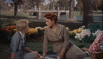 Posing as Sharon, Susan enjoys time with her mother (Maureen O'Hara) in an actual Boston park.