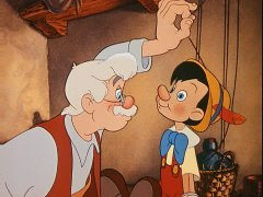 Geppetto pulls the strings to make his wooden puppet look up at him