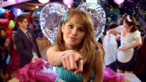 "Debby Ryan rocks out in front of her castmates in her ""A Wish Comes True Everyday"" music video, which differs from the song's outtakes-enhanced film-closing performance."