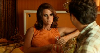 Often-alone neighbor Mrs. Samsky (Amy Landecker) serves Larry iced tea and marijuana with a side of conversation.