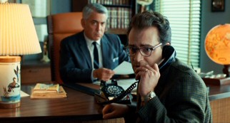 Larry (Michael Stuhlbarg) receives a troublingly trivial phone call while his divorce lawyer (Adam Arkin) is on the clock.