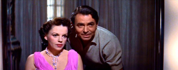 Actor Norman Maine (James Mason) prefers what he sees after undoing Esther's (Judy Garland) Hollywood makeover.