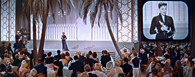 Life almost imitated art, but Judy Garland lost the Best Actress Academy Award to Grace Kelly in one of the Oscars' all-time closest races. As Vicki Lester, Garland accepts the statue onstage; winning in real life, she would have given her speech from a hospital bed.