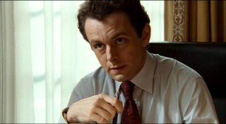 Michael Sheen depicts modern UK Prime Minister Tony Blair, who beginning his term in 1997, was the country's youngest leader in well over a century.