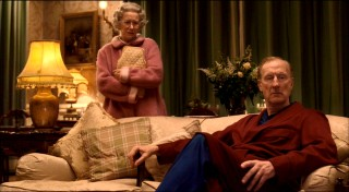 "Queen Elizabeth II and her husband Prince Philip (American actor James Cromwell, ""Babe"") watch news of Princess Diana's accident."