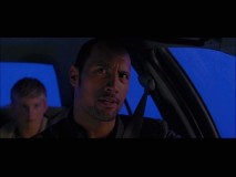 The Rock cracks wise while driving on Blue Screen Highway in the Bloopers reel.
