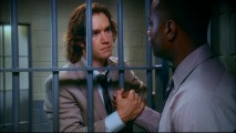 Prison bars are no match for a heartfelt handshake from Jerry Kellerman (Mark-Paul Gosselaar) in this shot from the Pilot episode.