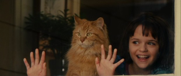 "Ramona (Joey King) lets her hands move with her cat Picky Picky in ""Ramona and Beezus."""