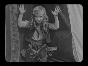"Alice (Virginia Davis) was Walt Disney's first star, headlining more than 50 comedy shorts in the 1920s. Here, she warms up the audience in ""Alice's Wild West Show."""