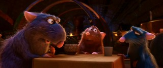 Django and Emile reunite with their kin, the designated poison checker. The family talks at a rat-sized table.
