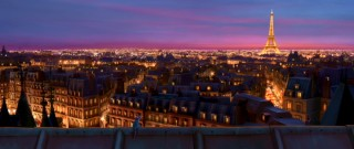 You can hardly see the little rat in this breathtaking rooftop shot of lit-up Paris at night.