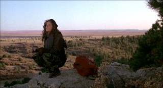 Against the scenic Calumet landscape, Lea Thompson crouches down for her best impression of a rifle-toting badass.
