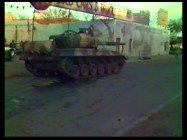 "Old, blurry footage from the set showcases the battle tanks being put to use in ""Building the Red Menace."""