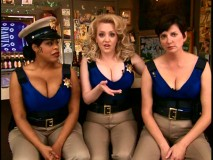 Williams (Niecy Nash), Johnson (Wendy McLendon-Covey), and Wiegel discuss the benefits of the new cleavage-boosting Kevlar for women.