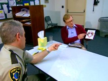 Deputy Garcia explains his assessment of an inkblot to state psychologist (Andrew Daly) in the Cop Psychology bonus feature.