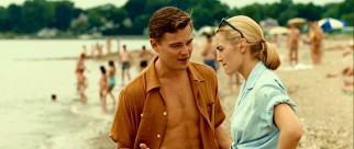 Decked in period beachwear, Frank (Leonardo DiCaprio) and April (Kate Winslet) discuss developments to their planned transatlantic move.