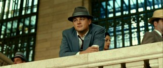Frank (Leonardo DiCaprio) is happy to have a quiet moment away from the hatted, suited hordes making their way around Grand Central.
