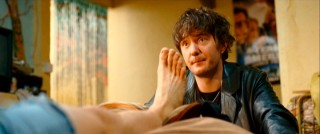 Dennis' best friend Gordon (Dylan Moran) is there for advice and support, like treating a giant foot blister.