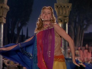 "The dance of the seven veils, as done by Rita Hayworth in ""Salome."""