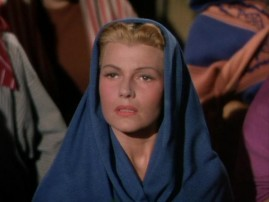 Salome (Rita Hayworth) looks very modest as she tries to blend in among the listeners of John's sermon.