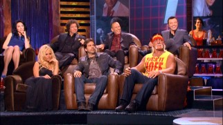 "Among those appearing on the dais of The Hoff's roast are, left to right, Whitney Cummings, Pamela Anderson, Jeffrey Ross, Greg Giraldo, Gilbert Gottfried, Hulk Hogan, roastmaster Seth MacFarlane, and, as set dressing, a receptive ""lifeguard"" in a red bathing suit."