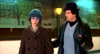 Rocky (Sylvester Stallone) woos mousy pet shop worker Adrian (Talia Shire) after hours on a closed ice skating rink.