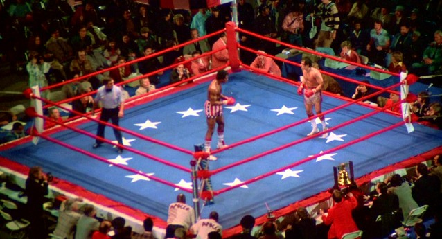 """Rocky"" closes with a patriotic New Year's Day fight between confident champion Apollo Creed (Carl Weathers) and working-class contender Rocky Balboa (Sylvester Stallone)."