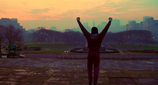 "Having confidently ascended the 72 stairs outside the Philadelphia Museum of Art now commonly referred to as ""the Rocky steps"", Rocky Balboa throws his hands in the air triumphantly in this shot from the film's iconic training montage."