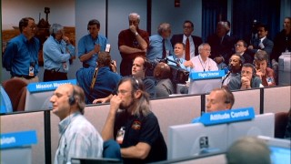 NASA scientists anxiously await news of the first rover's landing on Mars.