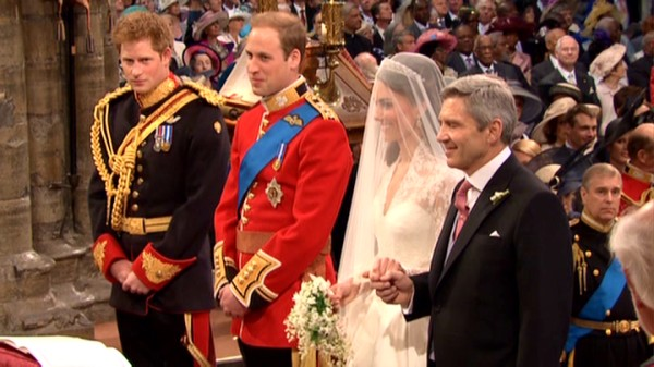 As the betrothed Prince William and veiled Kate Middleton smile, his brother/best man Prince Harry looks at the camera and her father/giver-awayer blinks.