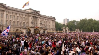 More than a few people gather outside Buckingham Palace hoping to witness in person the now customary post-wedding balcony wave.