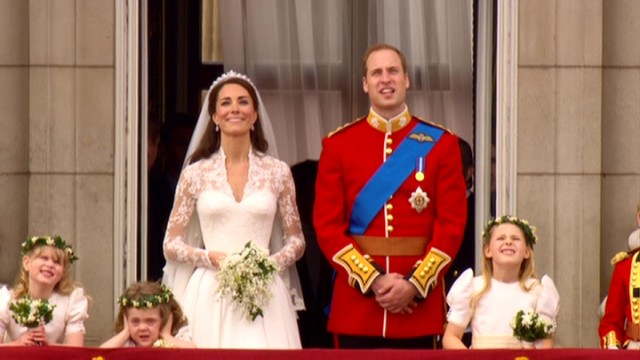 On the balcony of Buckingham Palace, Catherine Middleton and Prince William look up to admire the traditional aircraft fly-past, while young bridesmaid Grace Van Cutsem covers her ears in disgust.