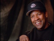 "Denzel Washington smiles in ""Denzel Becomes Boone."""