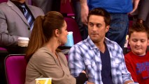 Even on her birthday, Adam (Oliver Hudson) finds it tough to pay attention to Jen while setting next to a boy (Noah Munck) with a handheld video game.