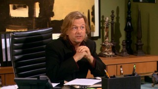 David Spade plays the rich, single, and shameless Russell Dunbar.